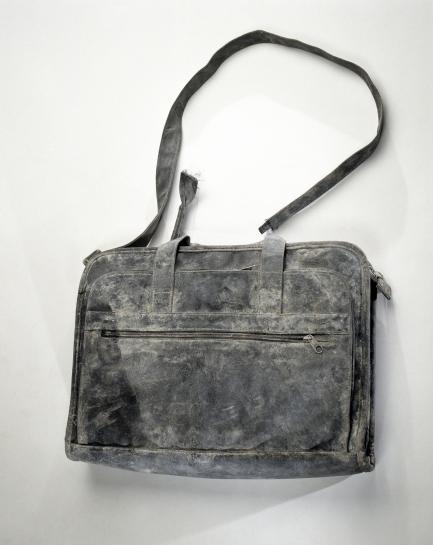 Battered black bag with shoulder strap