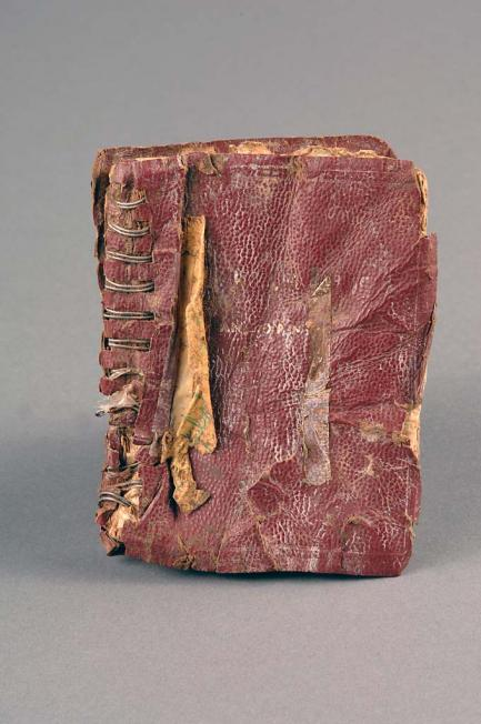 Battered notebook with reddish-brown cover
