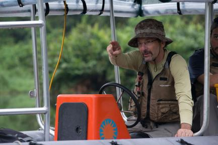 Man on boat pointing