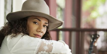 Promotional photo of Redbone wearing a hat