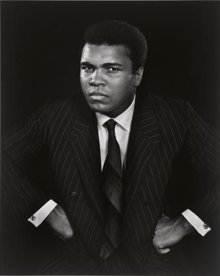 Portrait of Ali with hands on hips