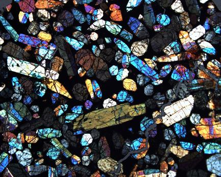 blue, orange, yellow, and cream colored coarse-grained minerals