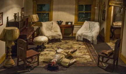 model of parlor with dead body