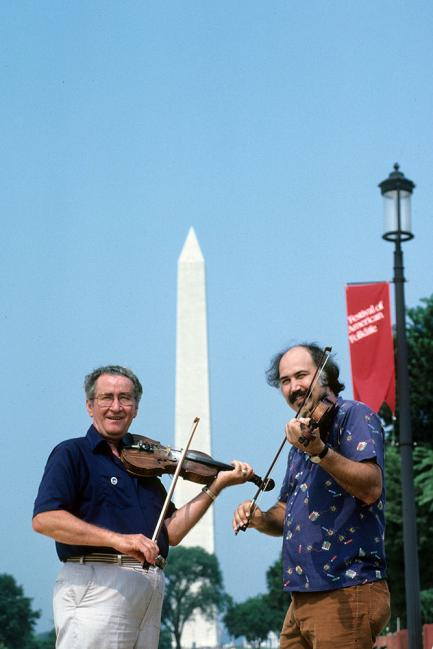 Two musicians with Washington monument in background