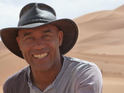 Casely-Hayford in the field, wearing hat