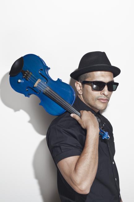 Quetzal Guerrero holding violin