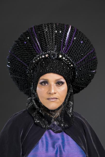 Photo of woman wearing elaborate headdress