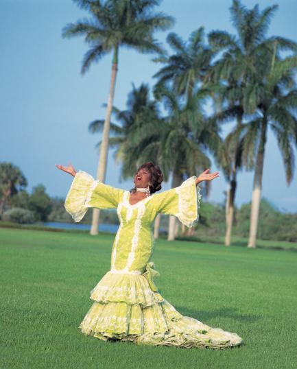 color portrait of Cruz in yellow flamenco dress