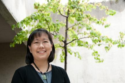 Portrait of Sasaki with green sapling in background