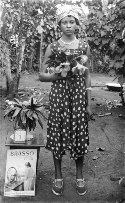 Young woman holding flowers