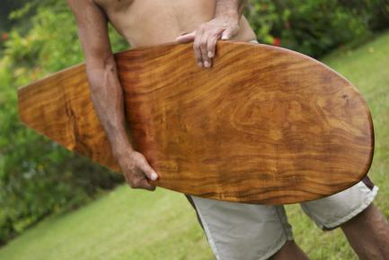 Tom Pohaku Stone with handcarved surfboard