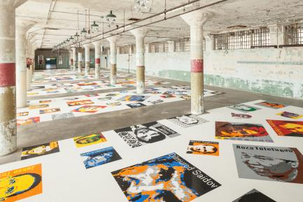 art exhibition with posters on white floor