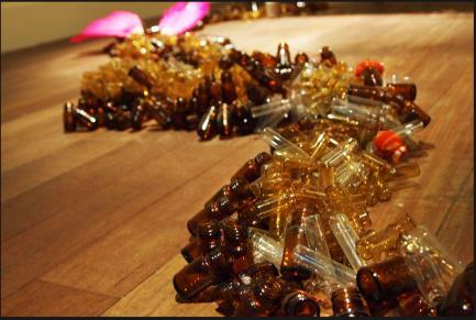Rina Banerjee - Trail of glass bottles