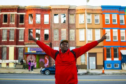 Man in red shirt with upraised arms