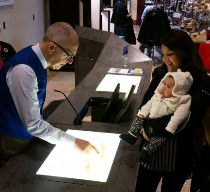 Skorton with Maria Anderson and baby at Castle volunteer desk
