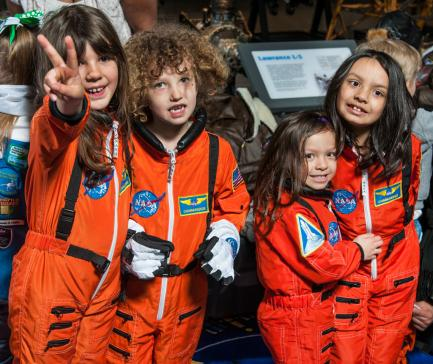 Young girls in astronaut uniforms