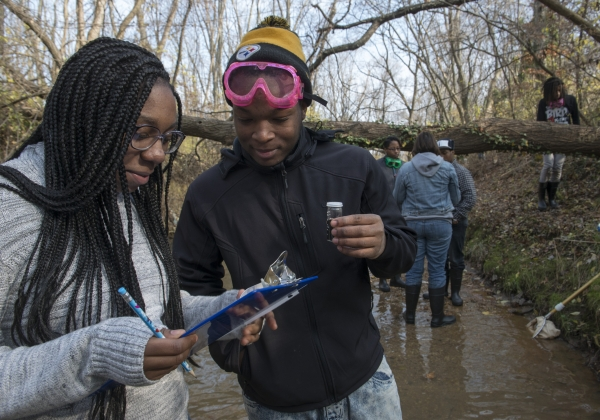 People gathering water samples for citizen science project.