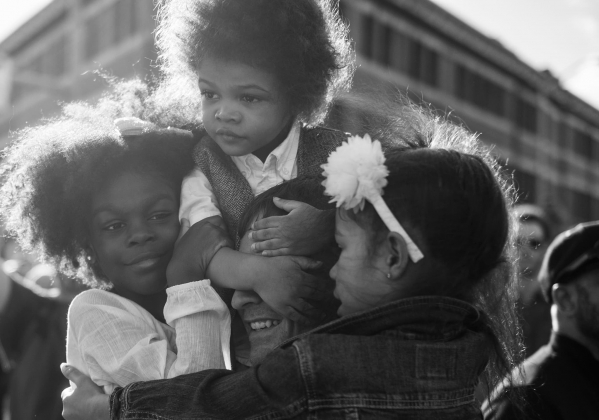 man holding children