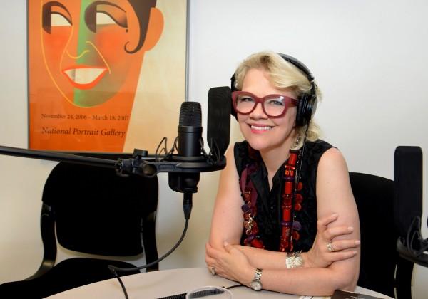 Kim Sajet at a microphone.