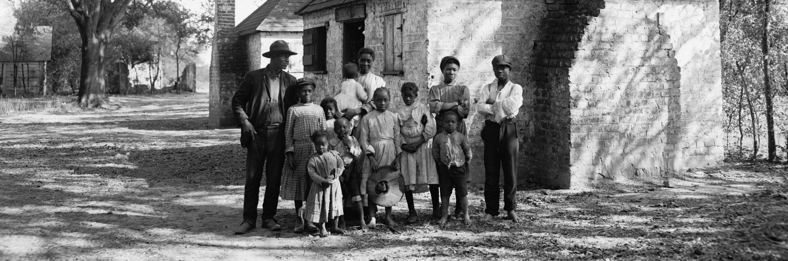 Family outside a plantation