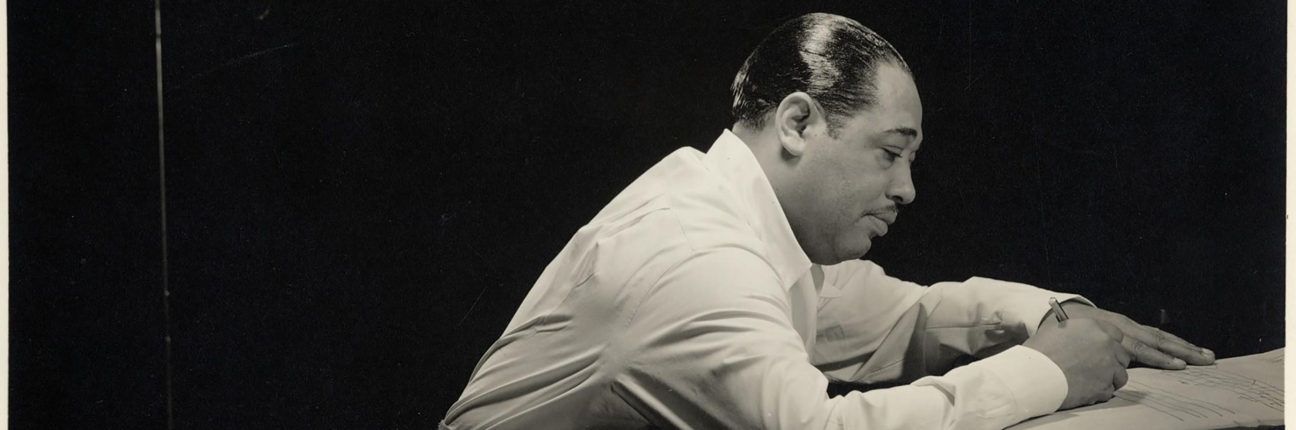Duke Ellington composing at a piano