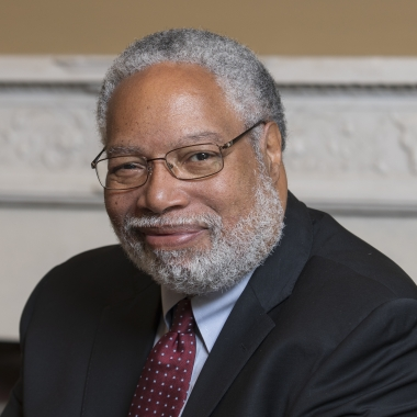 Secretary Lonnie Bunch sits at table